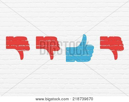 Social media concept: row of Painted red thumb down icons around blue thumb up icon on White Brick wall background