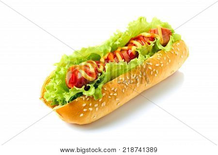Homemade hot dog with lettuce, mustard and ketchup isolated on white background