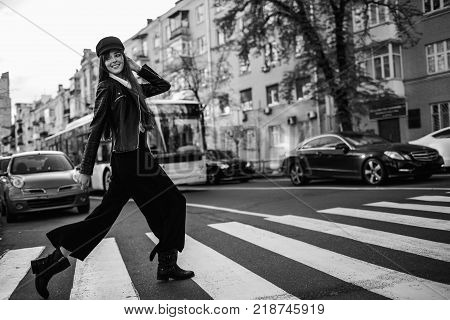 Beautiful Girl With Sunglasses. A Model In A Stylish Wide-brimmed Hat At A Pedestrian Crossing. Harm