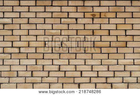 New brick wall. New brick background. New brickwork. New brick. Light brown brick background.