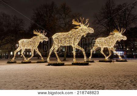STOCKHOLM - DEC 12, 2017: Gigantic elk or moose christmas decoration made of led light at Nybrokajen Stockholm Sweden. December 12, 2017