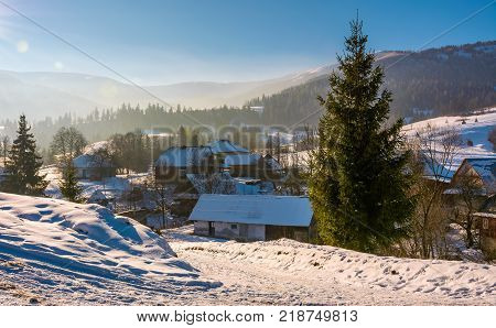 village in mountainous area in winter carpathian landscape. location Pylypets Ukraine