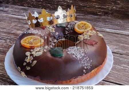 Roscon de reyes chocolate spanish desert to celebrate Epiphany or Dia de Reyes Magos Three Wise Men Day.
