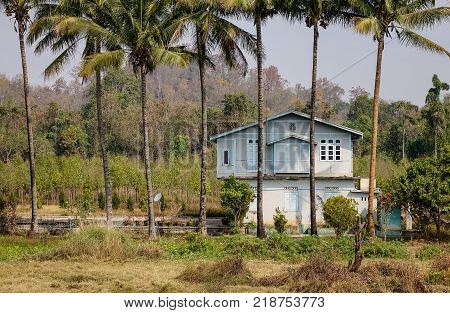 A rural house with palm trees in Shan State Myanmar.