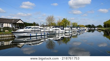 Boats moored alongside on the River Cam Cambridgeshire