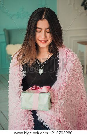 Christmas girl x-mas gift boxes new year, winter december, Smiling happy girl with gift box at decorated furtree, christmas interior and new year decoration. series