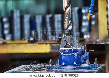 Metalwork drilling the metal detail in factory