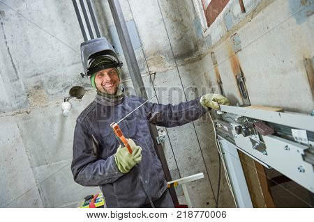 lift worker welder in elevator lift shaft