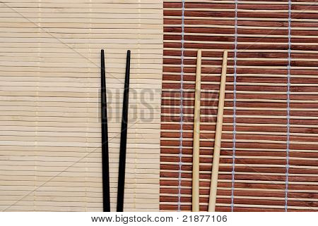 japanese chopsticks on bamboo placemat background