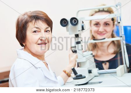 ophthalmology. female doctor portrait with patient