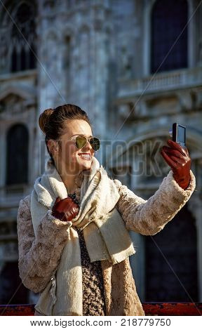 Traveller Woman With Digital Camera Taking Selfie In Milan