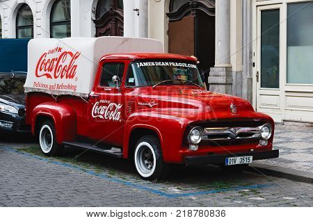 Prague, Czech Republic - July 6, 2017: An old renovated 1930 1940s Coca-Cola red delivery pickup truck 1934 Ford parking on the Prague street in Prague, Czech Republic.