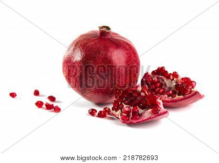 garnet and pomegranate seeds on a white background