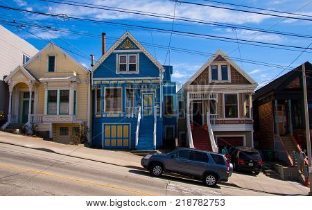 SAN FRANCISCO USA - OCTOBER 16, 2012: Image of a steep residential street with rows of houses stepping up the hill and car parked on the street