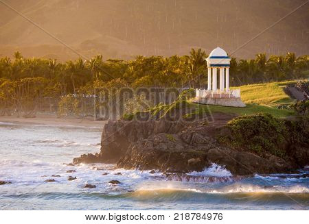 Idyllic Caribbean scene with gazebo and turquoise waters of the Caribbean Sea in the Dominican Republic.