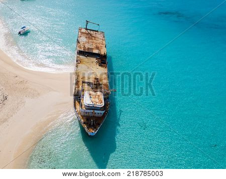 Aerial view of shipwreck in clear waters of Grand Turk island.