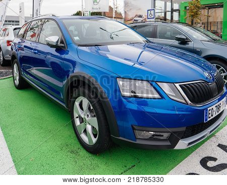PARIS FRANCE - NOV 7 2017: Essai text translated as Test Drive cars with Skoda Superb and Octavia cars made by Volkswagen at the car dealership garage