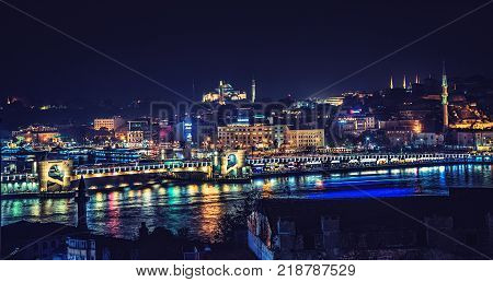 ISTANBUL TURKEY: Panoramic view of night Istanbul with Galata bridge Golden horn and Aya Sofia on a hill on October 6 2017