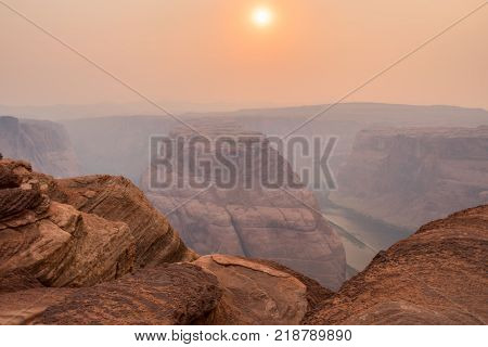 Afternoon Haze Over Horseshoe Bend in late summer afternoon
