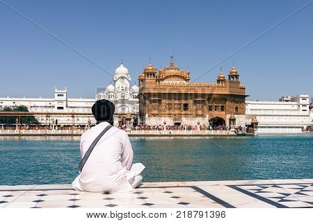 Sikh people wearing traditional clothes at Sri Harmandir Sahib known as Golden Temple located in Amritsar Punjab India.