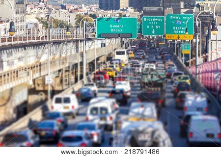Rush hour traffic jam with cars trucks buses and taxis on the Williamsburg Bridge in Brooklyn New York City NYC
