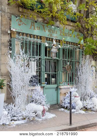 Paris, France-September 27, 2016 : The old traditional French cafe Au vieux Paris d'Arcole decorated for Christmas located in a touristy area, near Notre Dame cathedral, on Cite island.
