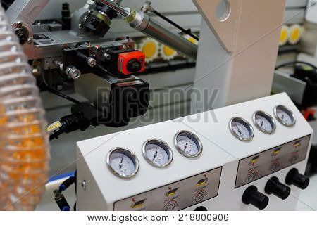 Closeup view of the automatic edge banding machine. Selective focus.