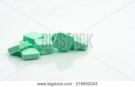 Medical lozenges for relief cough sore throat and throat irritation on white background with copy space. Apple flavored.
