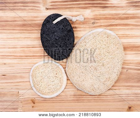 Real volcanic pumice stone and natural loofah sponge on wooden vintage background