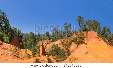 Ochre canyon near Roussillon in Provence France - travel and nature background