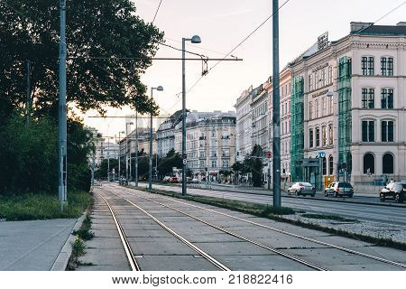 Vienna, Austria - August 15, 2017: Tramways in Karlsplatz in Vienna at sunset