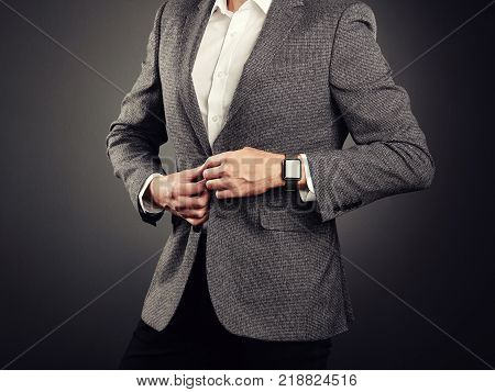 Handsome Young Man in Business Suit. Casual Style and Electronic Gadgets. Smart Watch Business style