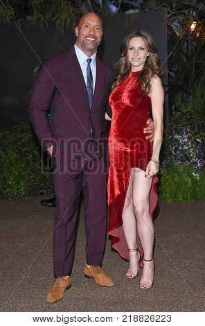 LOS ANGELES - DEC 11:  Dwayne Johnson and Lauren Hashian arrives for the 'Jumanji: Welcome To The Jungle' Los Angeles Premiere on December 11, 2017 in Hollywood, CA
