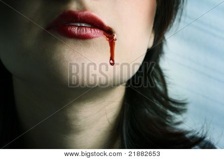 Red Lips With Blood Dropping By