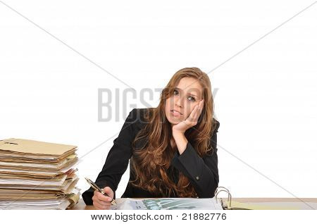 Business Woman At The Desk Dreaming