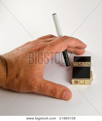 Hand of a man holding an electronic cigarette and a lighter