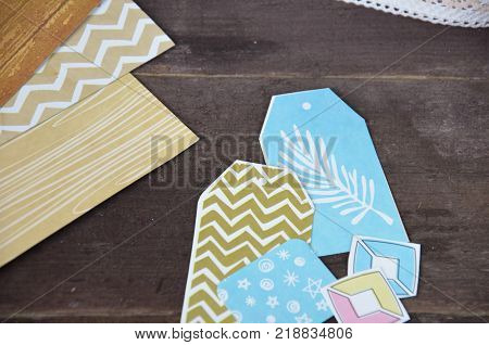 Top view of table with elements for scrapbooking, tools for decoration and handmade albums and cards. Craft materials. hobby