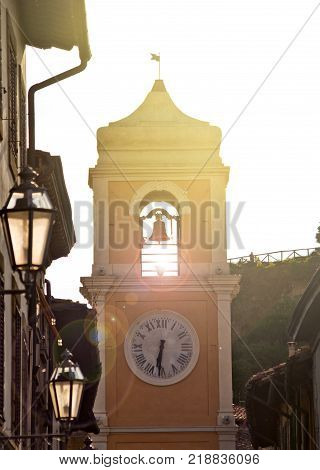 golden reflections of the sun at dawn illuminate the historic bell tower
