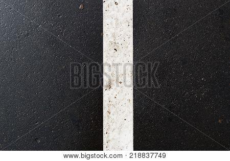 Road marking. Asphalt texture, asphalt background, scabrous asphalt. Grunge asphalt. Wet asphalt. Grunge asphalt.