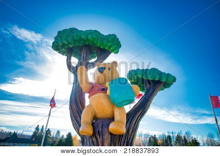 WHITE RIVER, ONTARIO, CANADA - OCT 20, 2017: View of Winnie the Pooh statue in the town of White River where the classic children's stories was found by Harry Colebourn.