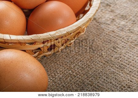 Easter composition. A few eggs in a thatched basket closeup