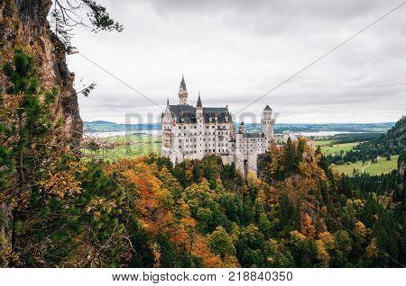 Neuschwanstein castle in colorful autumn day in Bavaria Germany