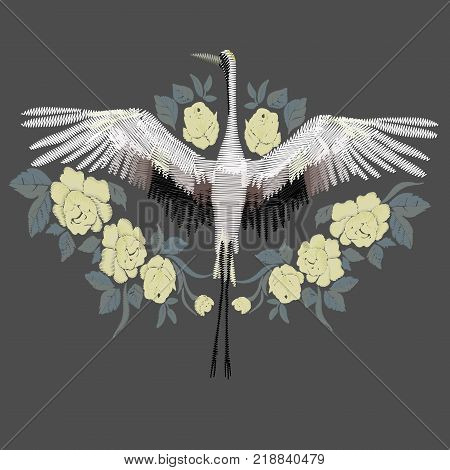 Embroidery. Embroidered design element - bird - crane - in vintage style on a black background. Stock vector illustration.