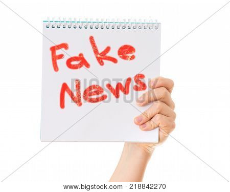 Fake News. Hand With Notepad On White Background