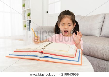 Little Kid Student Looking At School Textbook