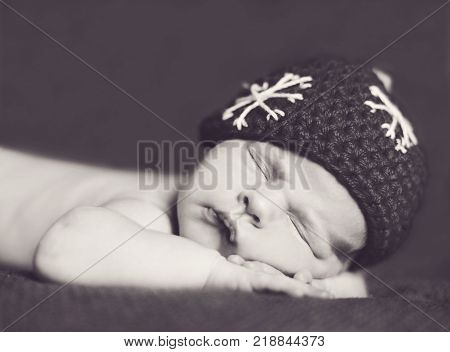 newborn baby wearing hat like a boll for christmas tree