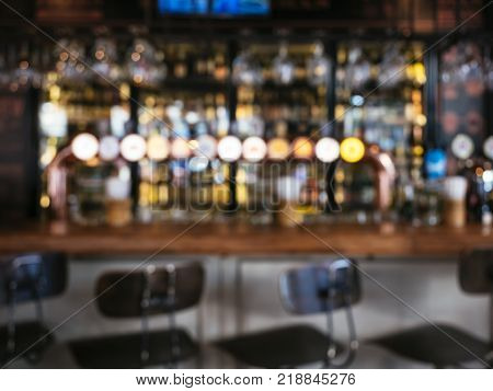 Bar counter Beer tabs with Stool seats Nightlife Blur background