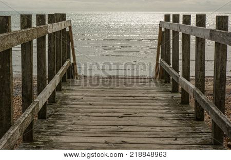 Boarded walkway onto shingle beach at Goring in Worthing West Sussex England