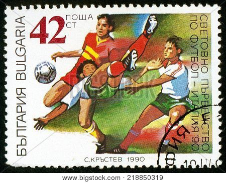 UKRAINE - circa 2017: A postage stamp printed in Bulgaria shows episode of the match World Football Championship Italia 1990 Series FIFA World Cup 1990 Italy circa 1990