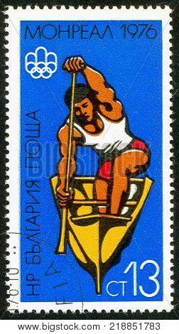 UKRAINE - circa 2017: A postage stamp printed in Bulgaria shows Canoe Racing Series Summer Olympics 1976 Montreal circa 1976